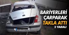 Bariyerlere çarpan otomobil devrildi: 2 yaralı